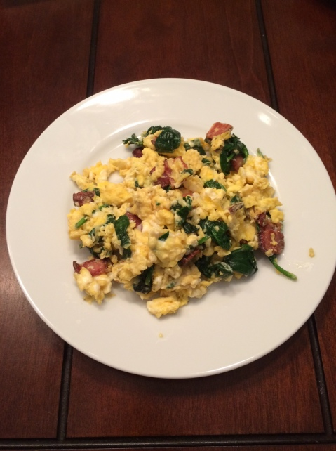 Scrambled eggs, spinach and Naked Bacon.